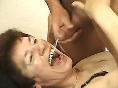 Brunette mom in black stockings gets cum in mouth