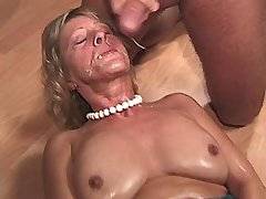 Mature fucks on table and on floor and gets facial