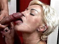 Blonde aged lady gets cum on face